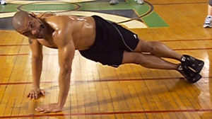 Darryl Hannah demonstrates push-ups.